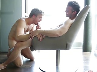 Gorgeous gay boys have dirty sex in front of a window