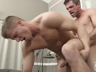 Muscled guys don't hold back during bareback anal sex