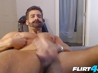 Sexy daddy with a beard enjoys masturbation on film