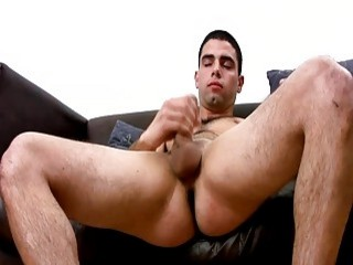 Cum covers the stomach of this Latino hunk after masturbation