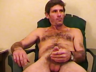 When he's not in prison, this hairy bear likes to jerk for the camera
