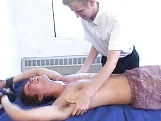 Tied up young man dominated by his partner with tickling