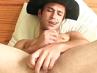 Gay cowboy smokes before stripping nude and stroking his boner