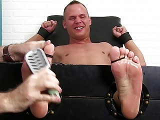 Naughty jock with a foot fetish restrained for kinky tickling