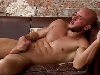 Bald stud shows off his muscles and jerks off solo