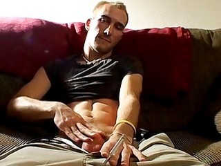 Jock relaxes solo while smoking and strokes his big schlong
