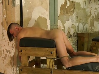 Submissive twink tied up and teased by an older gay