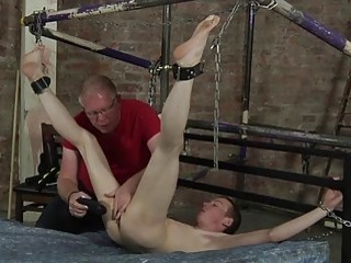Submissive twink shaved during gay BDSM play and fingered hard