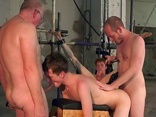 Two submissive twinks spit roasted in a gay domination foursome