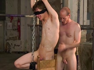Twink tied up for hot wax torment and gay domination