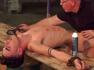 Twink tied up to have his dick shaved and stroked