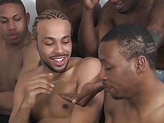 Black bros take turns sucking each other's dicks in group sex