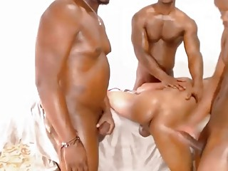 Oiled-up black guys have a gay threesome