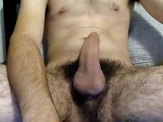 Super hairy dude is jacking his cock for the webcam