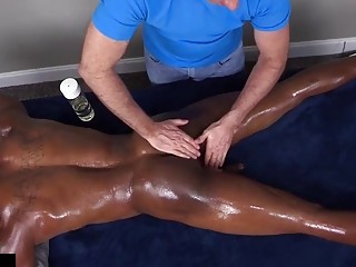 Straight black Adonis is oiled up, massaged and made to cum