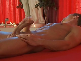 Ripped stud masturbates by candlelight