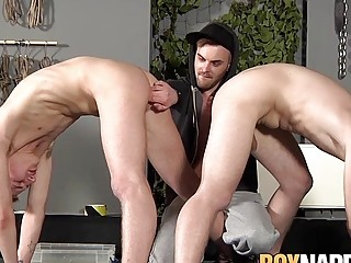 Young guy restrains two submissive dudes and does his will